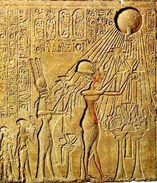 Pharaoh Akhenaten (Center) and His Family Worshiping the Aten (with characteristic rays seen emanating from the solar disc)